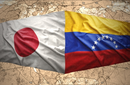 venezuelan: Waving Venezuelan and Japanese flags on the of the political map of the world