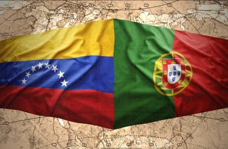 venezuelan: Waving Venezuelan and Portuguese flags on the of the political map of the world Stock Photo