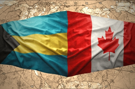 bahamian: Waving Bahamian and Canadian flags on the of the political map of the world