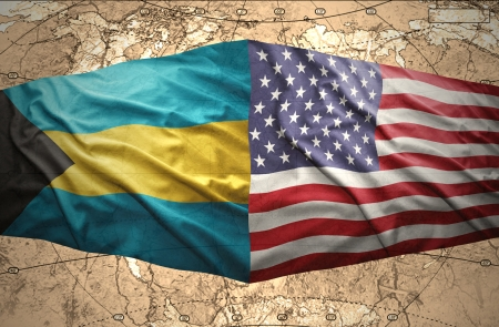 bahamian: Waving Bahamian and American flags on the of the political map of the world