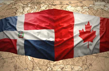 Waving Dominican and Canadian flags on the of the political map of the world photo