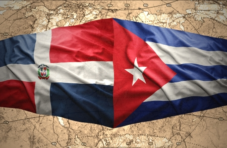 Waving Dominican and Cuban flags on the of the political map of the world photo