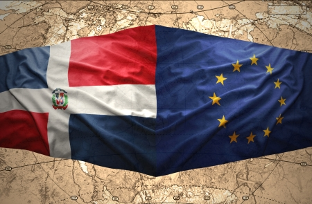 Waving Dominican and European Union flags on the of the political map of the world photo