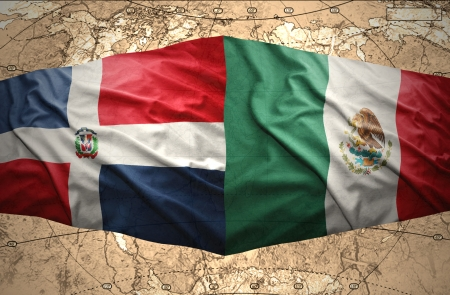 Waving Dominican and Mexican flags on the of the political map of the world photo