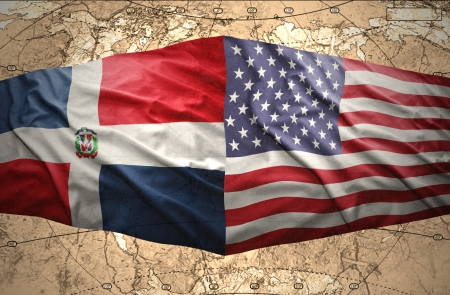 Waving Dominican and American flags on the of the political map of the world photo
