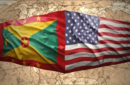 Waving Grenada and American flags on the of the political map of the world photo