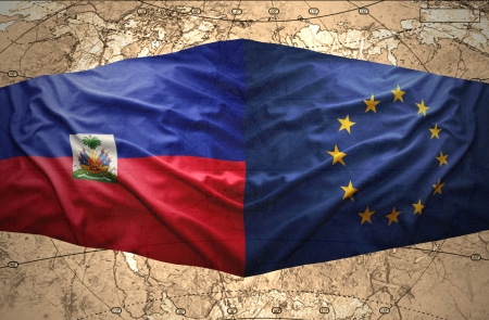 Waving Haitian and European Union flags on the of the political map of the world photo