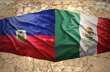 Waving Haitian and Mexican flags on the of the political map of the world photo
