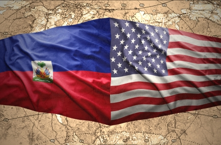 prince of peace: Waving Haitian and American flags on the of the political map of the world