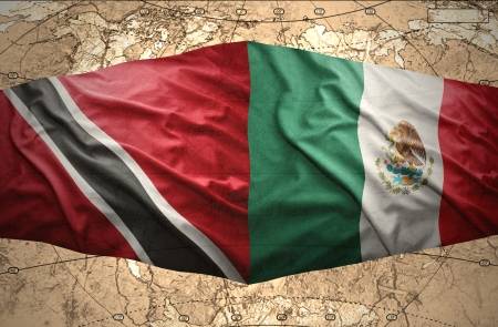 trinidadian: Waving Trinidadian and Mexican flags on the of the political map of the world Stock Photo