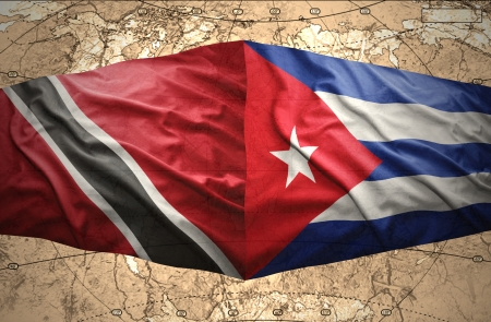 trinidadian: Waving Trinidadian and Cuban flags on the of the political map of the world
