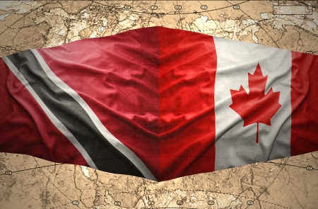 trinidadian: Waving Trinidadian and Canadian flags on the of the political map of the world
