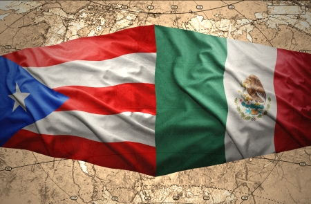 Waving Puerto-Rican and Mexican flags on the of the political map of the world