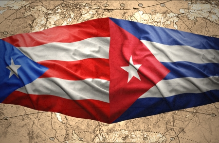 Waving Puerto-Rican and Cuban flags on the of the political map of the world photo