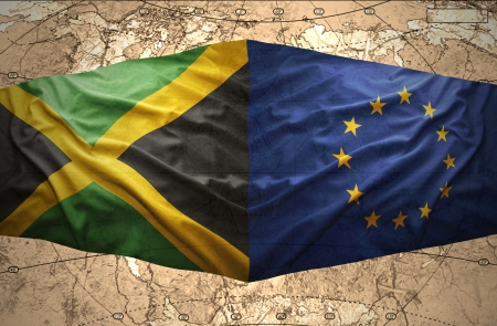 jamaican: Waving Jamaican and European Union flags on the of the political map of the world Stock Photo