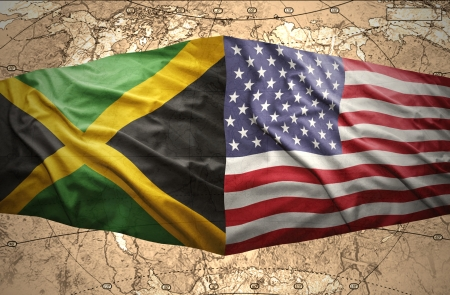Waving Jamaican and American flags on the of the political map of the world photo