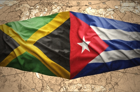 Waving Jamaican and Cuban flags on the of the political map of the world photo