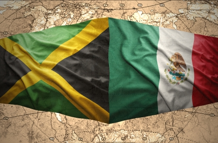 Waving Jamaican and Mexican flags on the of the political map of the world photo