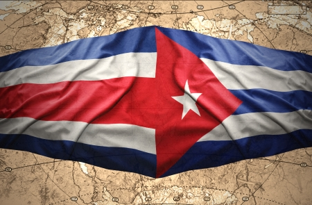 Waving Costa Rica and Cuban flags on the of the political map of the world photo