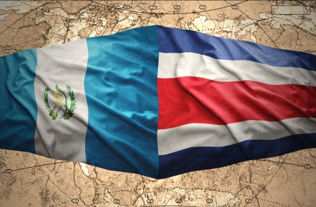guatemalan: Waving Guatemalan and Costa Rica flags on the of the political map of the world