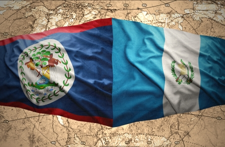 Waving Guatemalan and Belize flags on the of the political map of the world photo