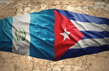 Waving Guatemalan and Cuban flags on the of the political map of the world photo