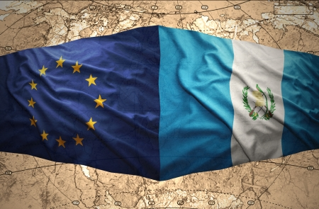 guatemalan: Waving Guatemalan and European Union flags on the of the political map of the world