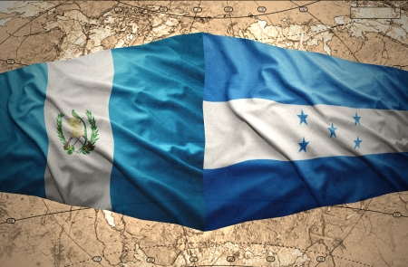 guatemalan: Waving Honduran and Guatemalan flags on the of the political map of the world