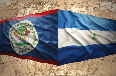 nicaraguan: Waving Nicaraguan and Belize flags on the of the political map of the world