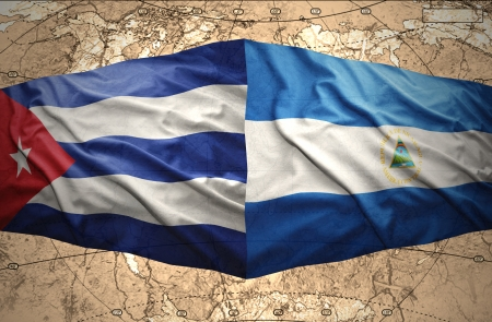 nicaraguan: Waving Nicaraguan and Cuban flags on the of the political map of the world Stock Photo