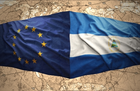 nicaraguan: Waving Nicaraguan and European Union flags on the of the political map of the world Stock Photo