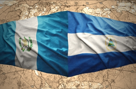 guatemalan: Waving Nicaraguan and Guatemalan flags on the of the political map of the world