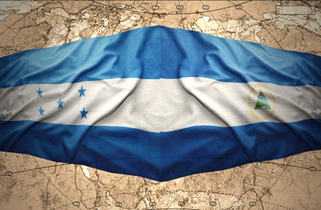 nicaraguan: Waving Nicaraguan and Honduran flags on the of the political map of the world Stock Photo