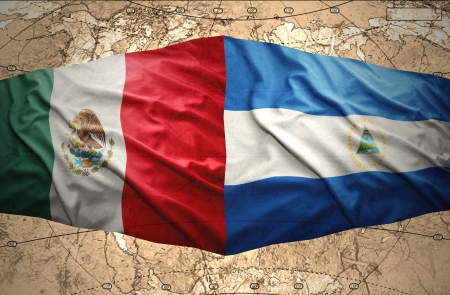 nicaraguan: Waving Nicaraguan and Mexican flags on the of the political map of the world