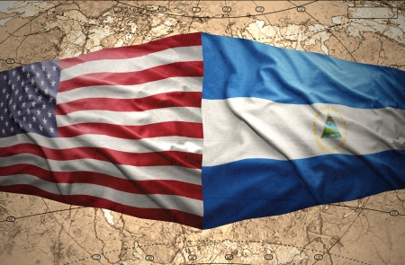 Waving Nicaraguan and American flags on the of the political map of the world photo