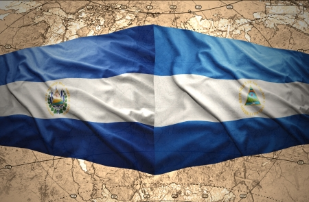nicaraguan: Waving El Salvador and Nicaraguan flags on the of the political map of the world