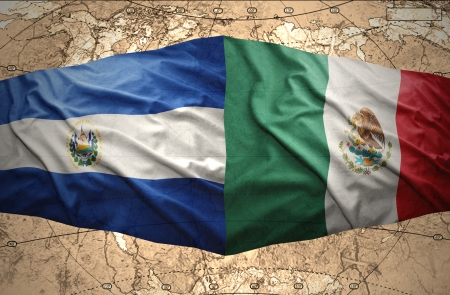 Waving El Salvador and Mexican flags on the of the political map of the world photo