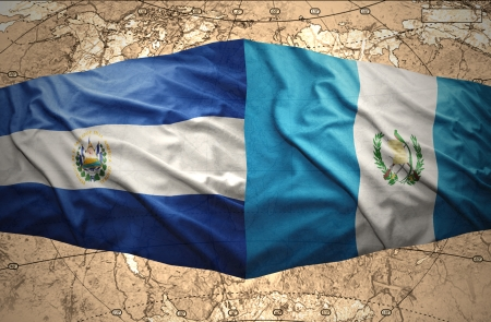 el salvador: Waving El Salvador and Guatemalan flags on the of the political map of the world
