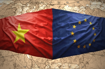 Waving Vietnamese and European Union flags of the political map of the world photo