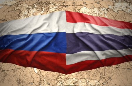 Waving Thai and Russian flags of the political map of the world photo