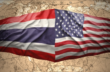 Waving Thai and American flags of the political map of the world photo