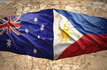 Waving Philippine and Australian flags of the political map of the world photo