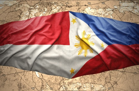 manila: Waving Philippine and Indonesian flags of the political map of the world