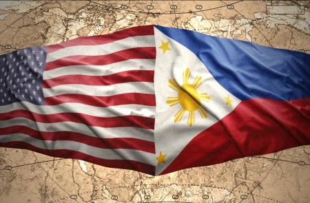 Waving Philippine and American flags of the political map of the world photo