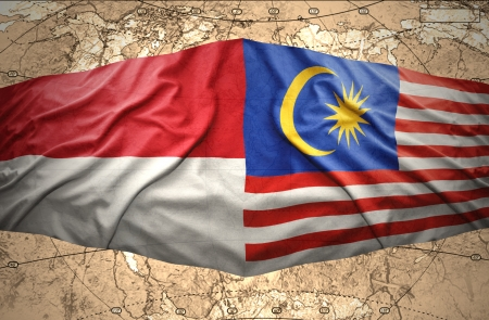 Waving Malaysian and Indonesian flags of the political map of the world photo