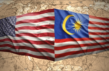 Waving Malaysian and American flags of the political map of the world photo