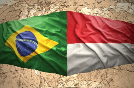 Waving Indonesian and Brazilian flags of the political map of the world photo