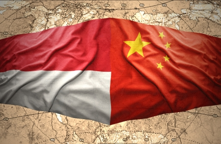 Waving Indonesian and Chinese flags of the political map of the world photo