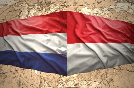 Waving Indonesian and Dutch flags of the political map of the world photo