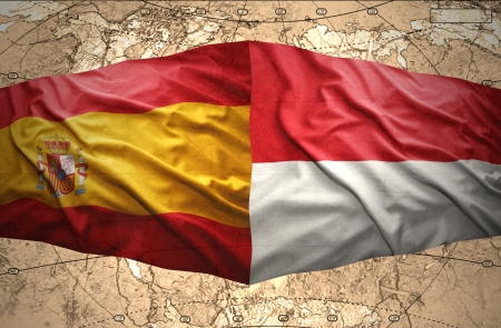 Waving Indonesian and Spanish flags of the political map of the world photo